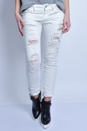 Spodnie jeansowe białe z dziurami