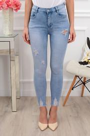 150fdb9af228 Spodnie jeansowe postrzępione z dziurami błękit ...