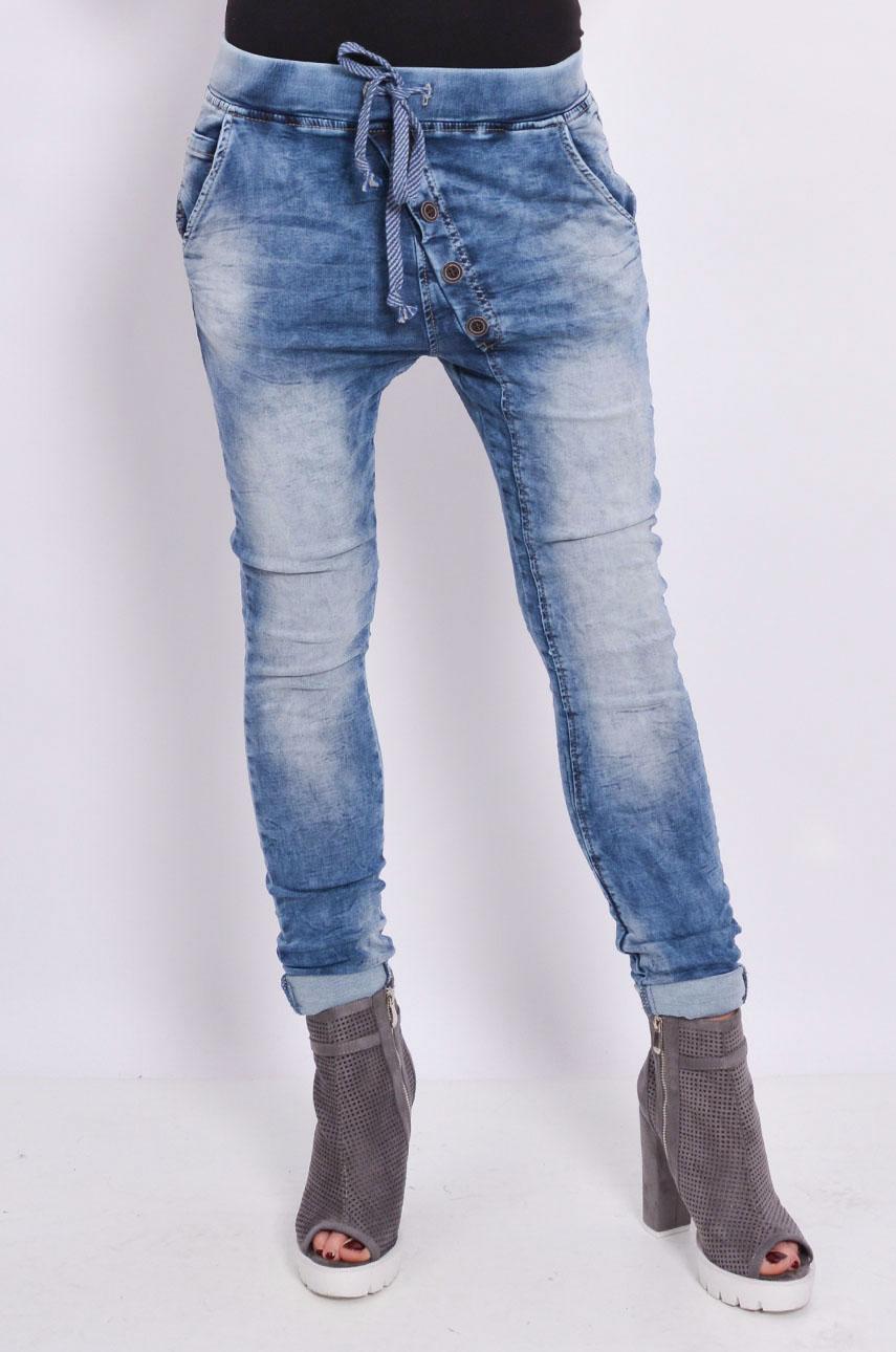 Spodnie jeans na gumie z guzikami na skos