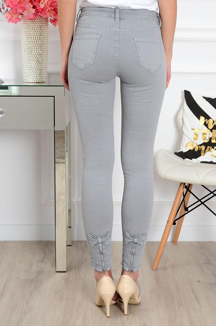 671e6208 Spodnie jeans z kokardkami i zamkami szare