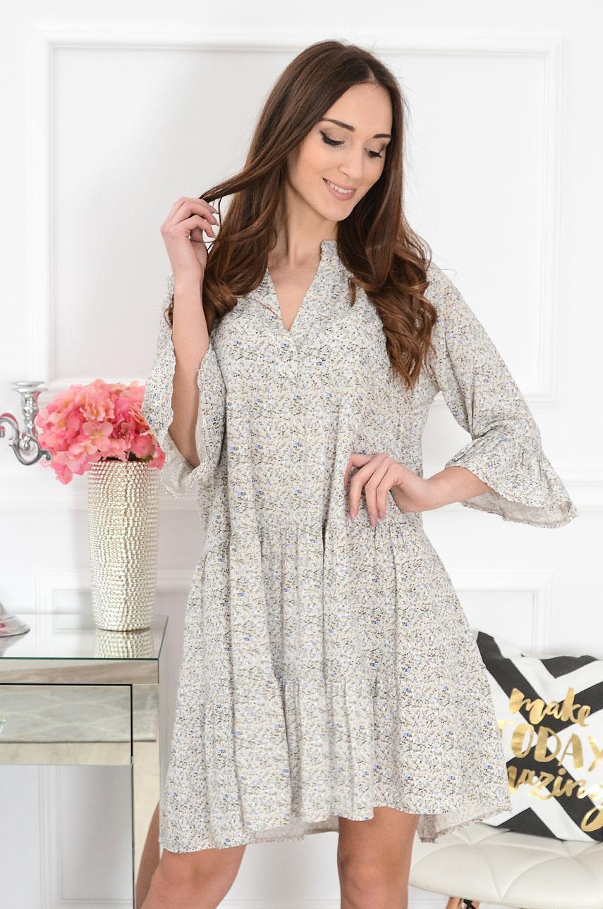 ee1152248e Sukienka oversize z falban w łączkę beżowa Lovi