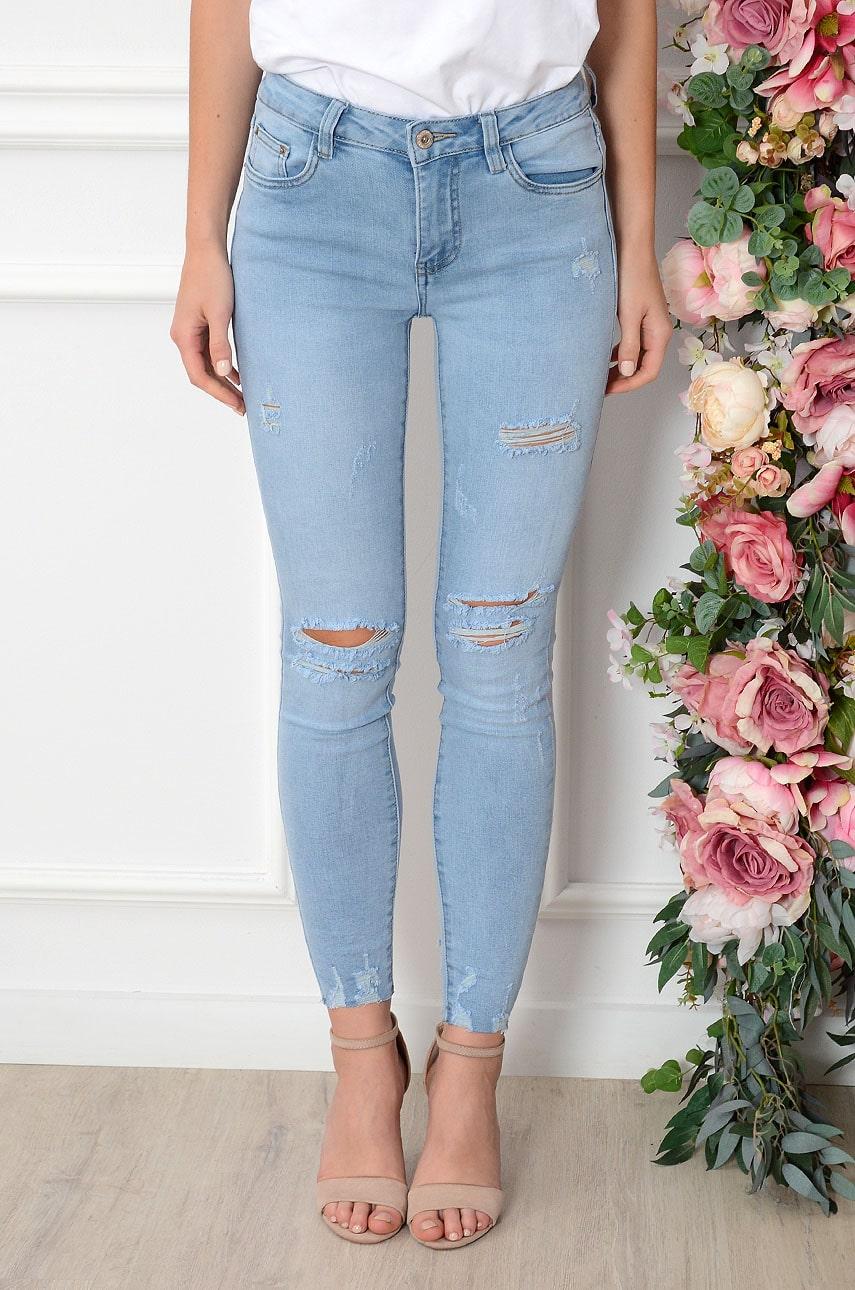 Spodnie jeansowe z dziurami jasny jeans Laos Rozmiar: XS